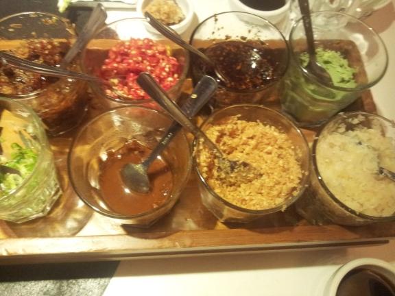 condiments platter - haebeehiam, chilli, chilli oil, wasabi, spring onions, sesame sauce, garlic etc
