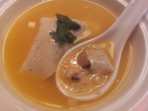 chicken & mushrooms in eggskin dumpling in pumpkin soup