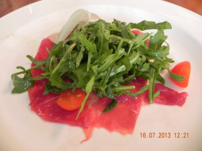 beef carpaccio with ricola salad & shaved parmesan