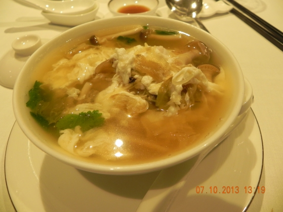 sliced fish century egg tan chai soup