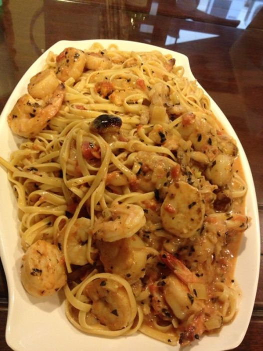crab linguine in pink sauce with medium prawns & pan-seared scallops