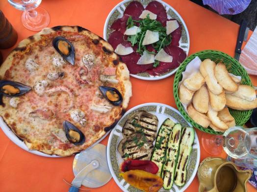 frutti di mare pizza, beef carpaccio, grilled eggplants, toast