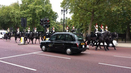 horse guards riding past