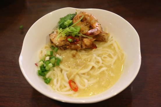 big prawn noodles in golden broth