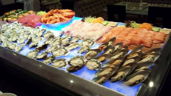 cold appetizers - oysters, mussels, scallops on shell, salmon, maguro & tai sashimi, prawns & some sushi