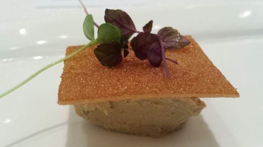 suckling pig - crackling skin on foie gras moussesuckling pig - crackling skin on foie gras mousse, pork & mushroom tempura in deep-fried squidink pasta