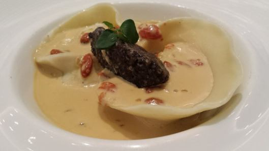 2 ricotta & grana padona cheese ravioli with truffle & wolf berries, excellent sauce