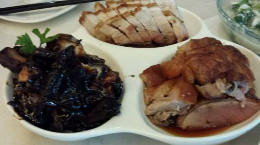 3 roasts = char siew, roast pork, roast duck