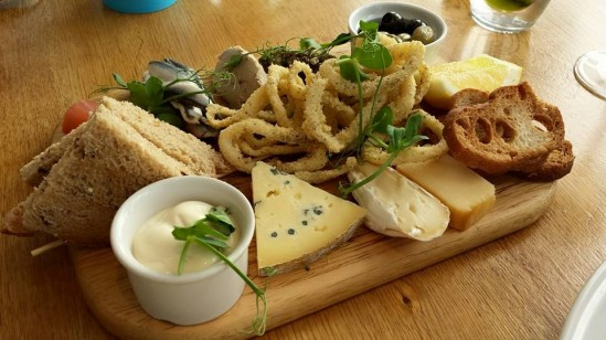 tasting board-aioli squid, chicken pate, cured herring, cheese platter, croutons, bread