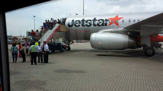 jetstar passenger disembarking at hong kong airport