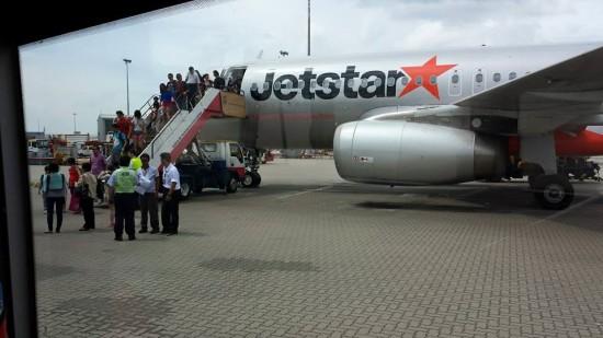 jetstar passenger disembarking at hong kong airport