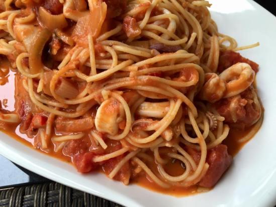 seafood spaghetti in pink sauce (creamy tomatoes)