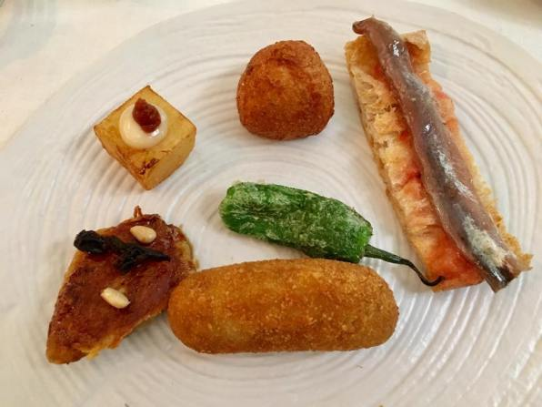 tapas - anchovy bruschetta, croquette, a marinated panfried mackarel etc