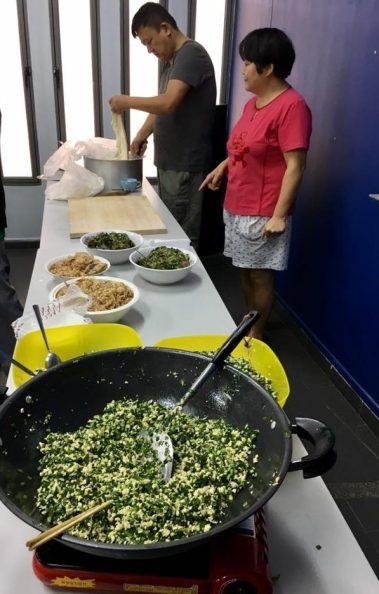one resident demonstrates making dumpling 饺子