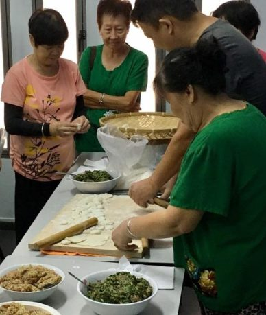 others trying their hands in making dumplings
